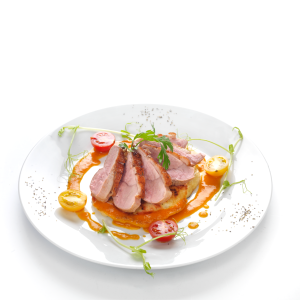 Rosé duck breast aged in thyme, with potato roundel