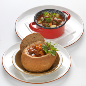 Hungarian Great Plain goulash soup in a small bowl, with Lipóti style farmer's bread