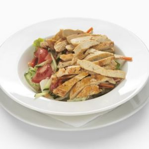 Fresh stirred, mixed salad with chicken